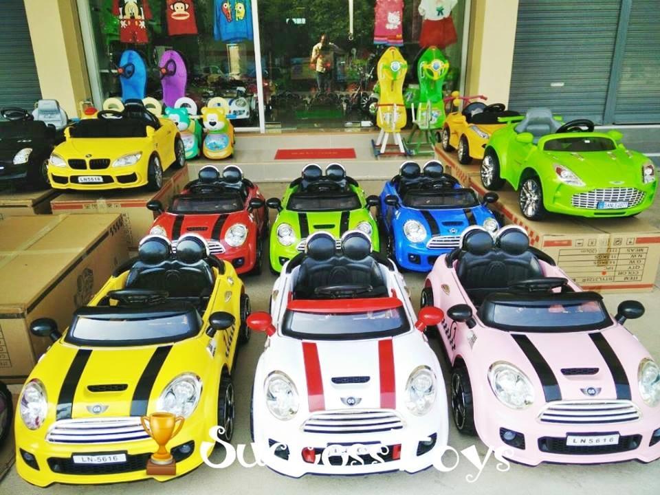 รถแบตเตอรี่เด็กนั่ง ยี่ห้อมินิคูเปอร์เปิดประตูได้2 มอเตอร์ 2แบต รุ่น LN5616 มี 6 สี แดง ขาว เหลือง เขียว ชมพู ฟ้า