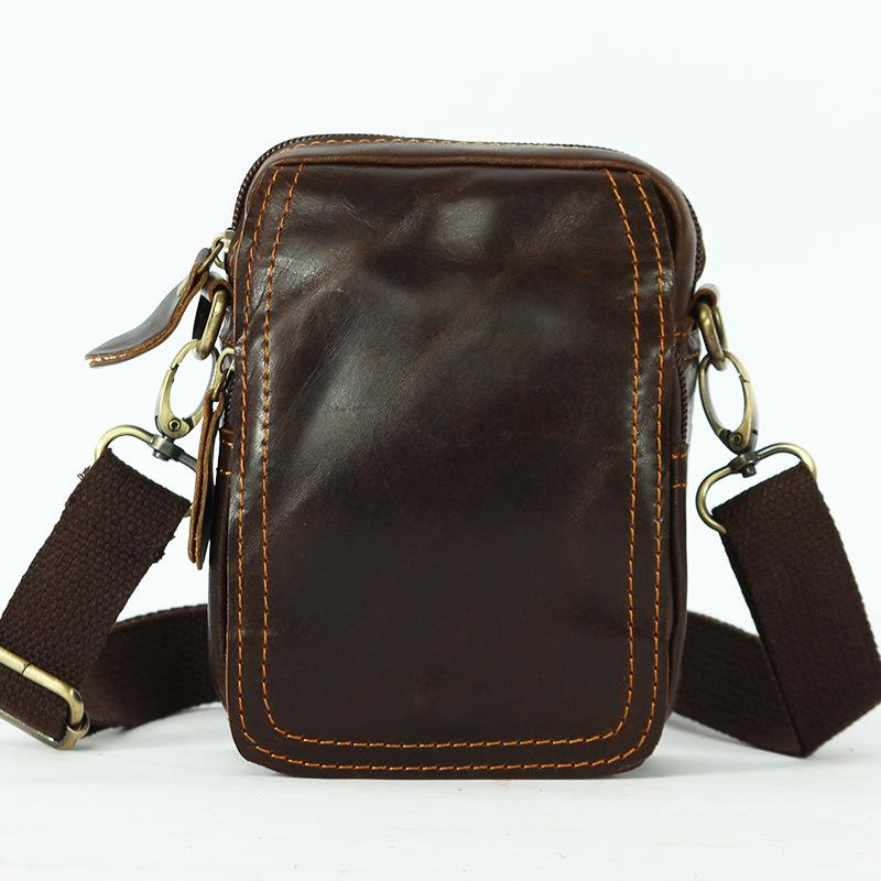 DM-5045 กระเป๋าคาดเข็มขัด สะพายข้าง หนังแท้ สีน้ำตาลแดง