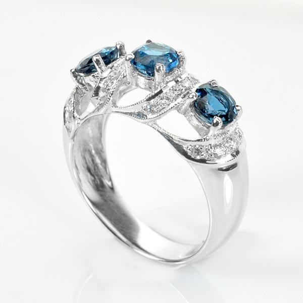แหวนพลอยแท้ แหวนเงินแท้ 925 ชุบทองคำขาว พลอยแท้ London Blue Topaz ล้อมด้วยเพชร CZ