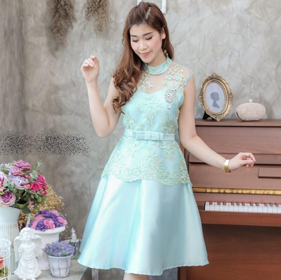 ชุดออกงาน ไปงานแต่งงานสีเขียวมิ้น เดรสสวยหรูผ้าลูกไม้ปักเลิ่อมสีทอง คอปิด แขนกุด กระโปรงบานทรงสวย