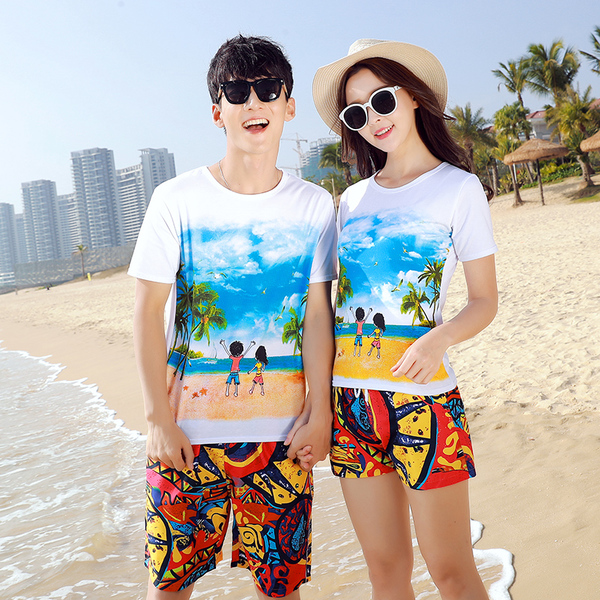 เสื้อคู่รัก ชุดคู่รักเที่ยวทะเลชาย +หญิง เสื้อยืดสีขาวลายคู่รักสวีทเที่ยวทะเล กางเกงขาสั้นลายพระอาทิตย์โทนสีส้ม +พร้อมส่ง+