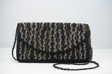 กระเป๋าปักลูกปัด กระดุม UK PAT1519246 UK.D973682