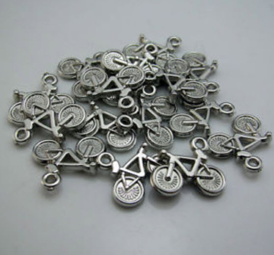 Bicycle bead acrylic ขนาด 15x21 ม.ม. / 100 ชิ้น