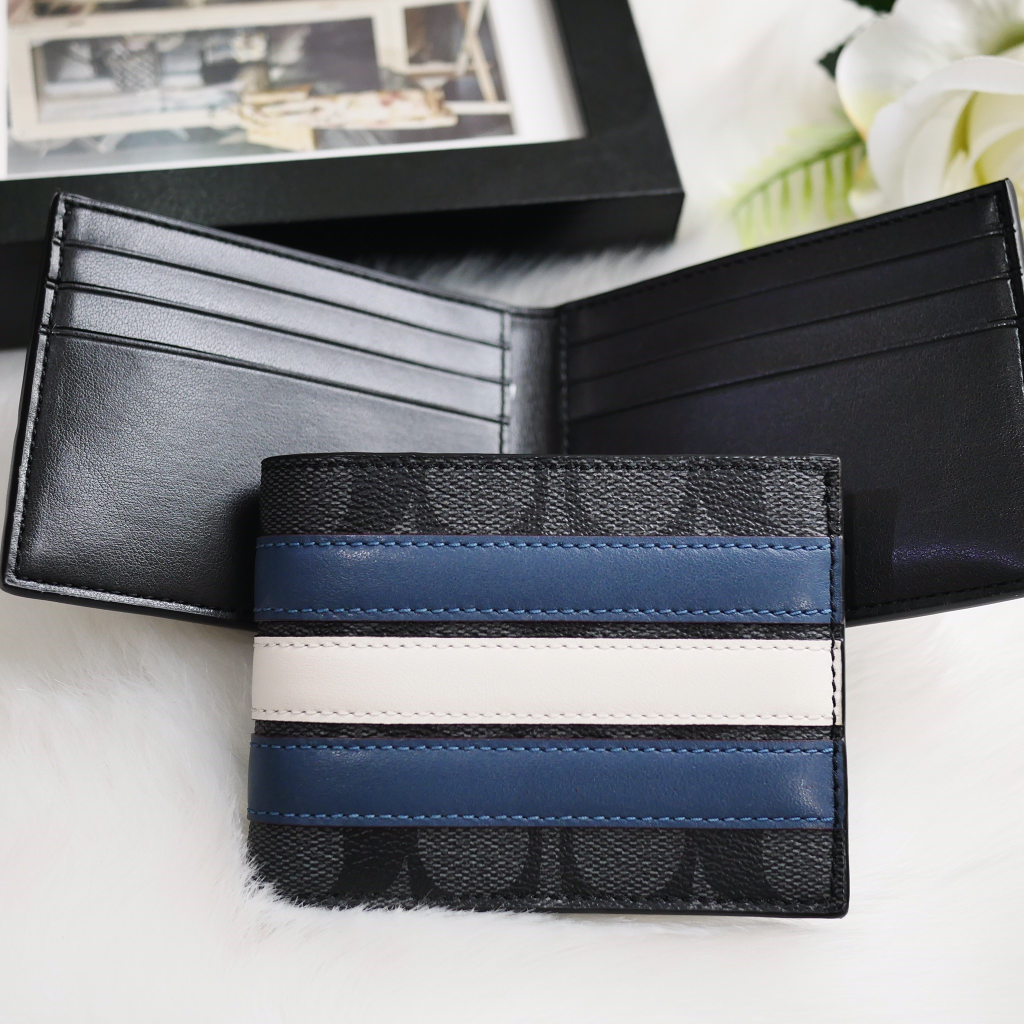 096781a0a9 กระเป๋าเงินแบบพับของผู้ชาย Coach slim billfold wallet in signature canvas  with varsity stripe
