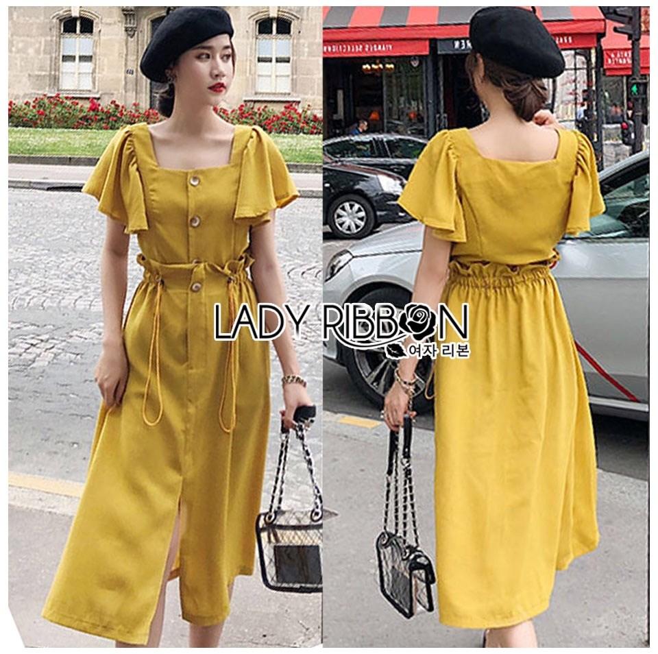 เสื้อผ้าเกาหลี พร้อมส่ง เสื้อคร็อปสั้นและกระโปรงสีเหลือง